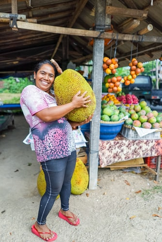 woman holding durian